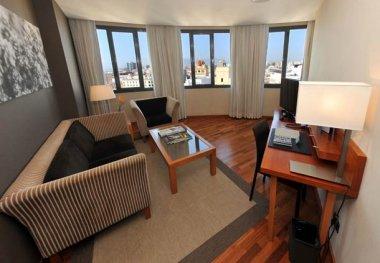 Ac hotel malaga palacio m laga descuentos especiales for Sala de estar palacio